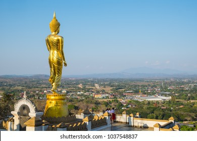 NAN, THAILAND - MARCH 2018 Golden stand Buddha statue in Wat Pra That Kao Noi on March, 2018. Wat Pra That Kao Noi which located in mountain of Nan Province. That can see city view of Nan.