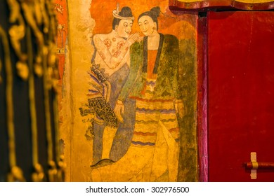 NAN ,THAILAND - November 24 : Traditional Thai mural painting on temple wall at Wat Phumin on November 24, 2013 in Nan, Thailand. The famous mural painting of a man whispering to the ear of a woman.