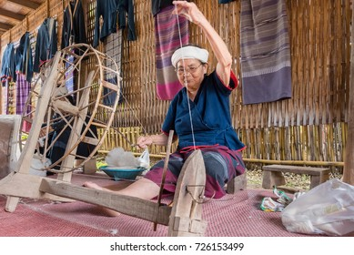 Nan, Thailand - September, 24, 2017 : Unidentified name old tribal thai women weaving traditional cotton woven at Nan Province, Thailand