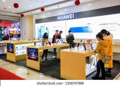 Nanchang, China - February 25, 2019: Consumers shop in Wanda Commercial Plaza in Nanchang, Eastern China.HUAWEI, the world's leading provider of information and communication technology (ICT) solution