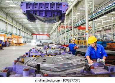 NANCHANG CHINA-May 9, 2018: Automobile workshop steel structure workshop is located in Nanchang, Jiangxi, Eastern China. Engineers use punching machines to make steel plates into car doors.