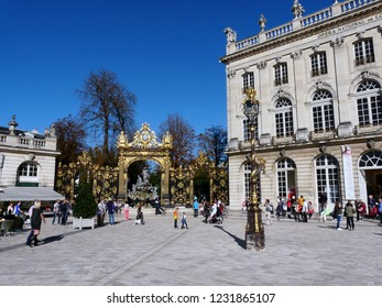 Nancy / France - 10.18.2014: Lorraine National Opera (right),  Fountain of Neptune (center) and Night club (left).