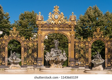 Nancy, France - 22 June 2018: Golden gate to the Place Stanislas square and Neptune Fountain in Nancy, France.