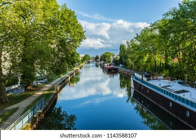 Nancy, France - 27 July 2018: Marne - Rhine Canal in Nancy - Lorraine, France. Beautiful cityscape. Lovely river, blue sky with clouds.
