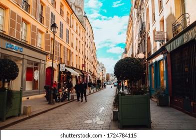 NANCY, FRANCE - Apr 05, 2020: Streets of France during winter with people and trees.