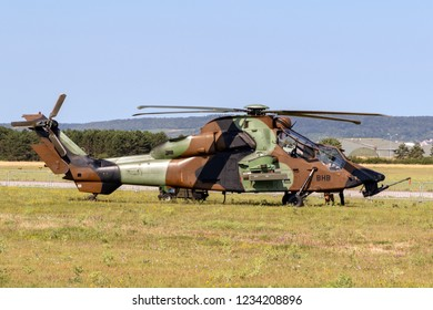 NANCY, FRANCE - JUL 1, 2018: French Army Eurocopter Airbus EC-665 Tiger attack helicopter in the grass of Nancy airbase.