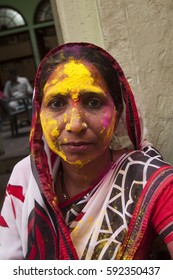 NANDGAON, INDIA, 18 MARCH 2016 : Unidentified women with face smeared with colors participate in the holi celebration at Krishna temple, . Holi is the most celebrated religious festival in India.