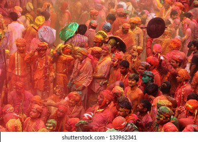 NANDGAON - MAR 22: Devotees celebrate a traditional and a colorful Holi at Krishna temple on March 22, 2013 in Nandgaon, India. Holi is the most celebrated religious festival in India.
