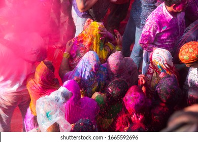 NANDGAON, UTTAR PRADESH, INDIA, 16 MARCH 2019 : Large crowd of Hindu devotees playing with colourful powders and celebrating Holi in temple at Nandgaon near Mathura during Holi Uttar Pradesh, India.