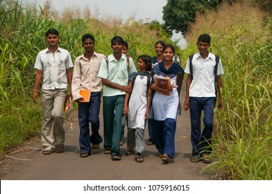NANDURBAR, MAHARASHTRA, INDIA 15 JULY 2017 : unidentified Happy Indian rural school student going to school together from their village to urban area for education.