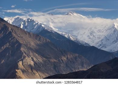Nanga Parbat mountain massif above the cloud, ninth highest peak in the world in Himalayas mountain range, Pakistan, Asia