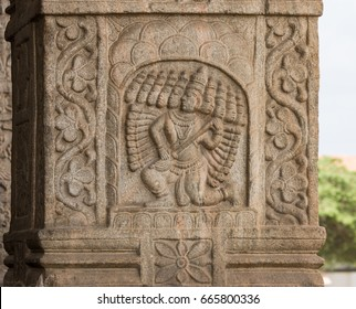 Nanjangud, India - October 26, 2013: Closeup of chiseled mural of Lord Ravana with his ten heads  in beige sandstone of the Mandapam at Srikanteshwara Temple.