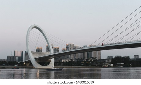 Nanjing, China 12 Agutus 2019 18.58 p.m - Lanscape of the Nanjing Bridge, revealing the buildings behind and the ships crossing the river.
