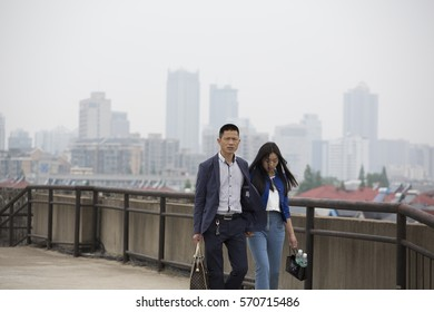 NANJING, CHINA - APRIL 24, 2016: Young couple walking on the historical city wall