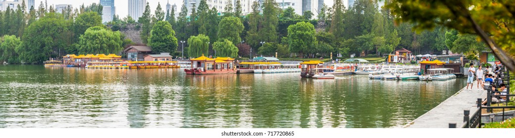 NANJING, CHINA - AUGUST 13, 2017: Pier with cruise boats in the Xuanwu Lake park. Nanjing, China 2017.