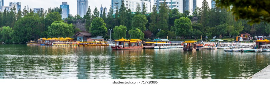 NANJING, CHINA - AUGUST 13, 2017: Yellow cruise boats at the pier in the Xuanwu Lake park. Nanjing, China 2017.