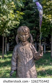 Nanjing / China - July 30th 2015: Statue of a girl in The Memorial Hall of the Victims in Nanjing Massacre by Japanese Invaders, memorializing victims killed in the Nanjing Massacre (1937-1938)