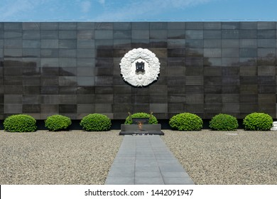 Nanjing / China - July 30th 2015: Eternal flame in The Memorial Hall of the Victims of Nanjing Massacre by Japanese Invaders, remembering victims killed in the Nanjing Massacre by the Japan Army