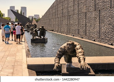 Nanjing / China - July 30th 2015: The outdoor exhibition of sculptures in The Memorial Hall of the Victims of Nanjing Massacre by Japanese Invaders, remembering victims of the Nanjing Massacre