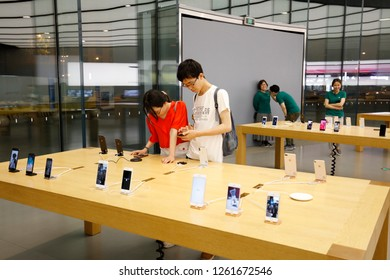 NANJING CHINA-April 30, 2018: In Apple's flagship store, consumers use iPhone electronics. Qualcomm asked Chinese courts to ban Apple from selling the iPhone XS and XR.