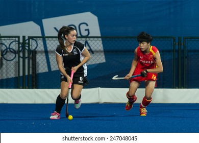 NANJING, CHINA-AUGUST 20: New Zealand Hockey Team (black) plays against China Hockey Team (red) during Day 4 match of 2014 Youth Olympic Games on August 20, 2014 in Nanjing, China. China wins 8-3.
