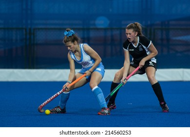 NANJING, CHINA-AUGUST 21: New Zealand Hockey Team (black) plays against Uruguay Hockey Team (blue) on Day 5 match of 2014 Youth Olympic Games on August 21, 2014 in Nanjing, China. Uruguay wins 6-3.