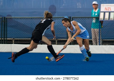 NANJING, CHINA-AUGUST 21: Uruguay Hockey Team (blue-white) plays against New Zealand Team (black) on Day 5 match of 2014 Youth Olympic Games on August 21, 2014 in Nanjing, China. Uruguay wins 6-3.