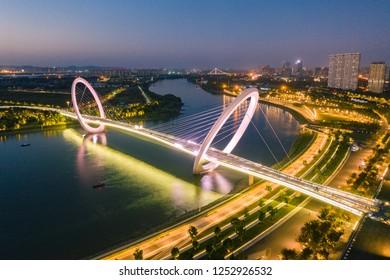 The Nanjing Eye Pedestrian Bridge at Sunset in Nanjing City