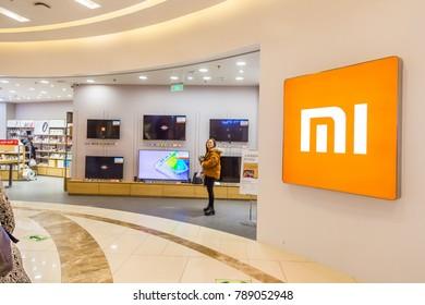 Nanjing Jiangsu China, 08 January 2018: Xiaomi Mi flagship store in mall in central China and chinese people shopping