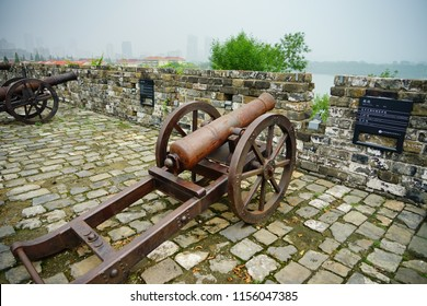 Nanjing, Jiangsu / China - July 03 2018: Old Chinese City Wall and cannon