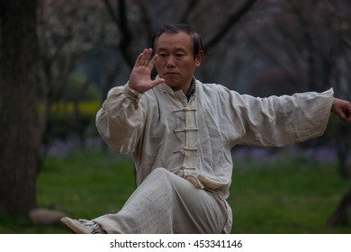 NANJING,JIANGSU,CHINA-MARCH 03:Old man activities for motion and movement  of kungfu fighting at Mochouhu park on March 03,2016 in Nanjing of Jiangsu province,China