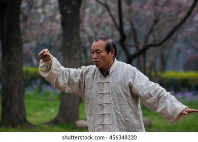 NANJING,JIANGSU,CHINA-MARCH 03:Old man activities for motion and movement  of kungfu fighting and meditation at Mochouhu park on March 03,2016 in Nanjing of Jiangsu province,China