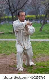 NANJING,JIANGSU,CHINA-MARCH 03:Old man activities for motion and movement  of kungfu fighting and meditation at Mochouhu park on March 03,2016 in Nanjing of Jiangsu province,China.