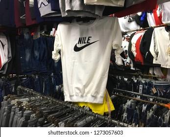 """NANNING, CHINA - CIRCA NOVEMBER 2018 : """"NIKE"""" LOOK ALIKE clothes sold at the store."""