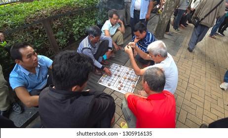 NANNING, CHINA - CIRCA NOVEMBER 2018 : Local elderly people playing XIANGQI (Chinese chess) at the park.