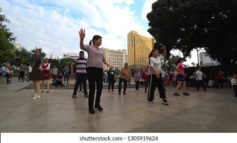 NANNING, CHINA - CIRCA NOVEMBER 2018 : Local people enjoying DANCING EXCERCISE at the park.