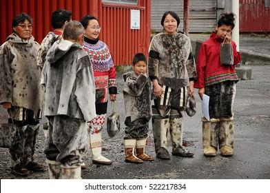 NANORTALIK, GREENLAND - SEPTEMBER, 2013: Inuit eskimo group welcoming tourist to their home town