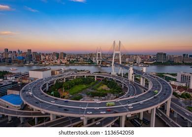 The Nanpu bridge in Shanghai, China at dusk