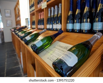NANSTALLON, ENGLAND - MARCH 4, 2019: Wide closeup of multiple bottles of award-winning sparkling wines on display at Camel Valley Winery. Travel and Cornish wines.