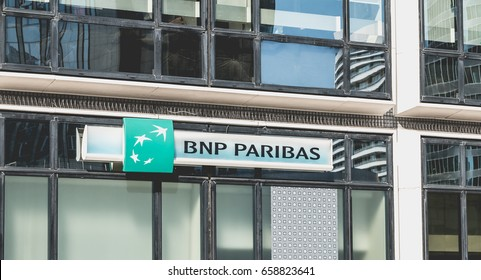 "Nanterre, FRANCE, May 09, 2017 - Close-up on the sign of an agency of ""BNP PARIBAS"" a French international business bank whose headquarters is in the defense, the business district of Paris, France"