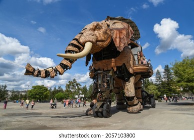 Nantes, France, 17 september 2021: The Great Elephant, attraction of Nantes walk with  passengers aboard.