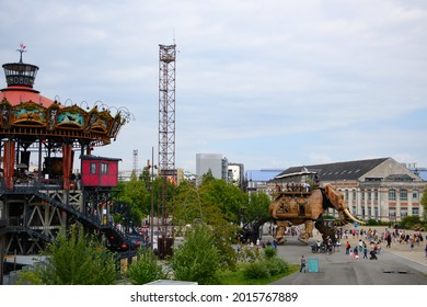 Nantes, France - 26-07-2021 : The great mechanical elephant of nantes with the carousel