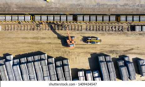Nantes, France - April 9 2019 : Heavy machines loading concrete railway sleepers on a train