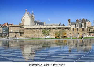 NANTES, France – August, 18, 2018 : View on the castle of Dukes of Brittany with  tourists in Nantes city in France