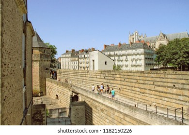 NANTES, France – August, 18, 2018 : Tourists on the ramparts of the castle of Dukes of Brittany in Nantes city in France