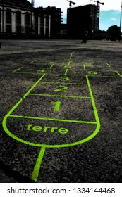 Nantes, France - August 4, 2013: Hopscotch game drawn on the asphalt with green paint