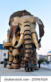 NANTES, FRANCE - CIRCA DECEMBER 2009: The Great Elephant goes for a walk with passengers aboard.