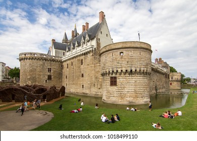 NANTES, FRANCE - JULY 29, 2014: People visiting The Château des ducs de Bretagne (Castle of the Dukes of Brittany) in summer in the city of Nantes, France, on July 29, 2014