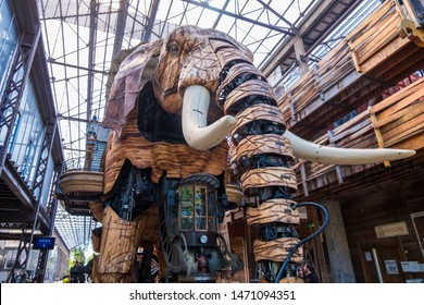 Nantes, France - May 12, 2019: The Great Elephant is part of the Machines of the Isle of Nantes carrying passengers in city square in Nantes, France