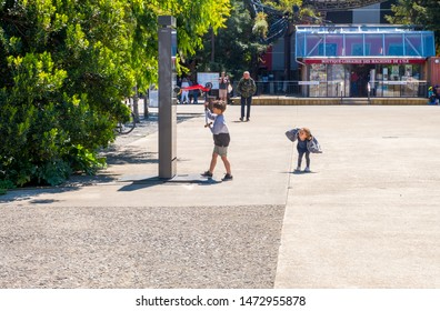 Nantes, France - May 12, 2019: Children play in the square near the Hangar des Machines of the Isle of Nantes, France